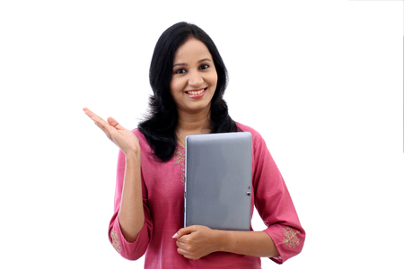 joy pad: Happy young woman with tablet computer against white background Stock Photo