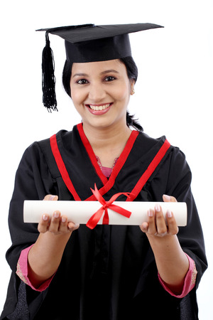 Happy young female student holding diploma against white background Stock Photo