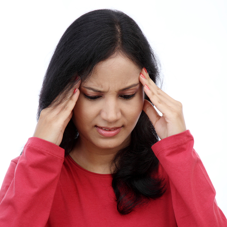 Young woman has a headache caused by stress Stock Photo