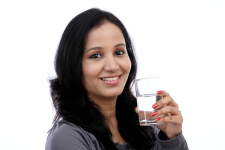 girl teeth: Young woman drinking water