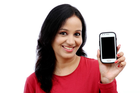 Beautiful young woman holding mobile phone against white background Banco de Imagens