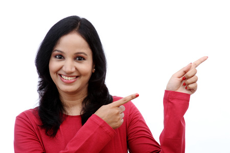 Smiling young woman showing isolated presentation against white photo