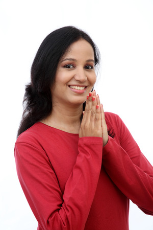 Young woman holding hands in prayer position photo