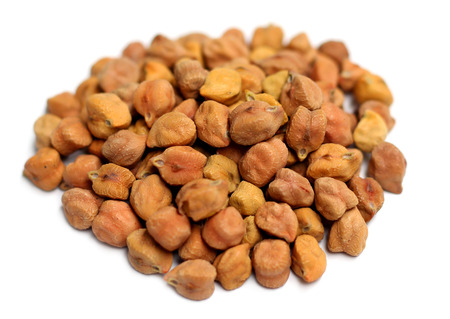 Close up of dried chickpeas over white background Stock Photo
