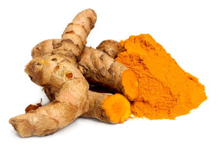 Fresh turmeric over white background