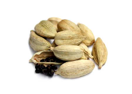 Cardamom seeds on a white background 写真素材