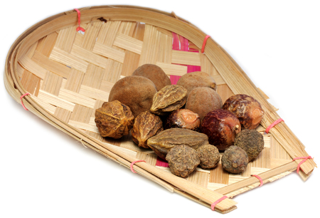 Ayurvedic fruits on bamboo basket have medicinal properties. Imagens