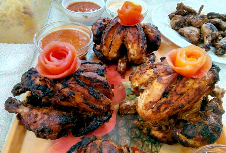 Grilled fried roast Chicken with tomato sauce on tray in a party