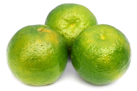 Green orange fruits over white background