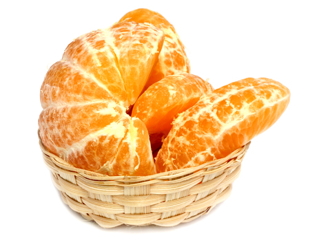 Ripe orange on bamboo basket isolated on white background