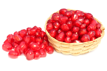 Red Pulp of pomegranate fruit on white background Imagens