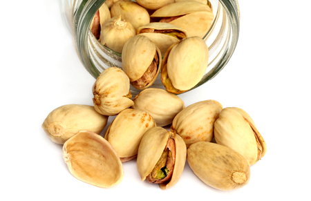 Pistachio nuts isolated on white background Imagens