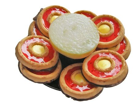 poignant: half of onion among the sweet cakes