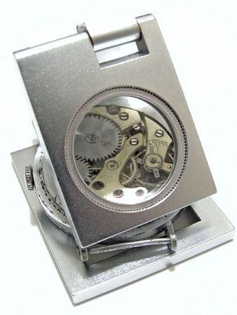 portative: watch mechanism under the portable enlarging lens