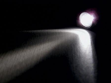 blackout: Lighting flashlight at dark night with light like arrow