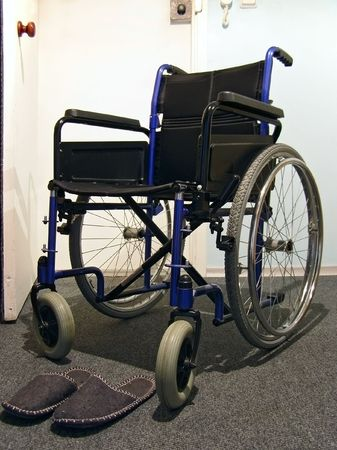Single wheelchair with the sneakers in the hospital Stock Photo - 2523027