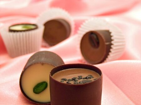 comfit: Different chocolate sweets at the pink silk