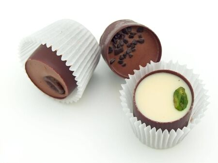 comfit: Different chocolate sweets against the white background Stock Photo