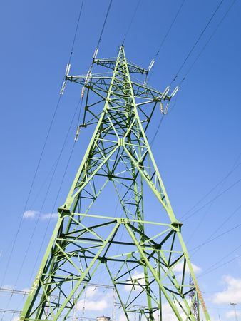 energies: Single electricity tower against the blue sky Stock Photo
