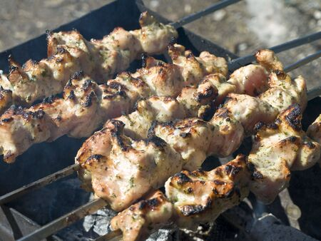 chargrill: shish kebab preparing at the chargrill outdoor  Stock Photo