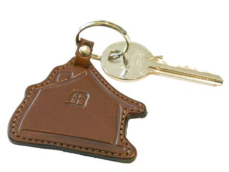 Isolated house key against the white background  photo