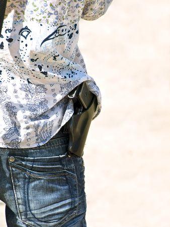 sidelong: part of man body with sidelong gun Stock Photo