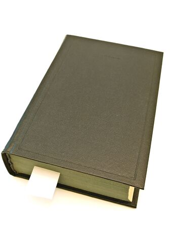 encyclopedias: Single book with book marker at the white table Stock Photo