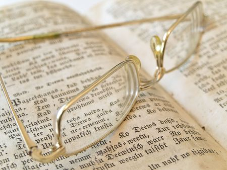 old open book with gold color glasses  photo