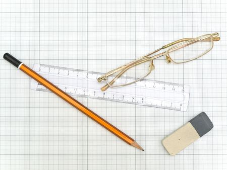 the plotting: glasses, pencil, eraser and ruler at the plotting paper Stock Photo