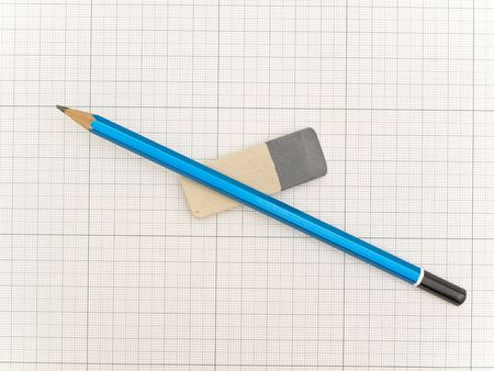 the plotting: Blue pencil and eraser at the plotting paper