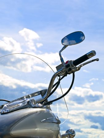 motorcycle handle bar against blue cloudy sky Stock Photo