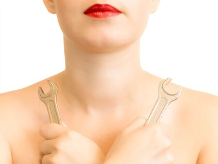 Half woman body with two metal spanners photo