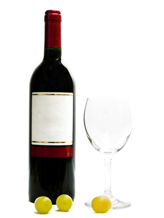 bottle of the red wine with wineglasses and grape against the white background photo