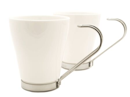 metall and glass: two white modern cup over the white background