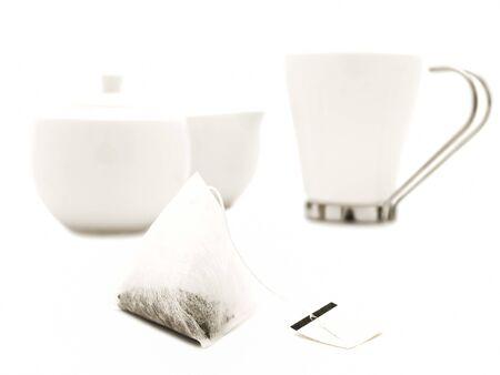 teaset:  white modern tea-set over the white background