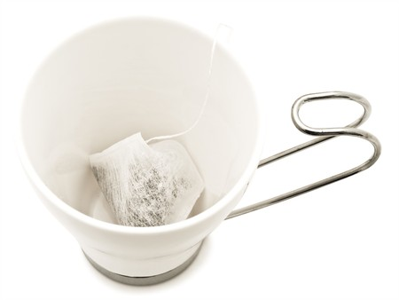 white modern cup without water but whith  teabag inside over the white background Stock Photo