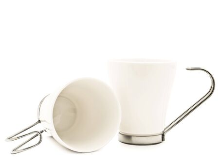 metall and glass: two  white modern cups over the white background