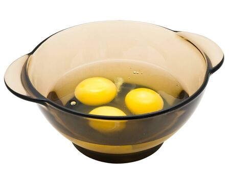 eggs in the bowl against the white background photo