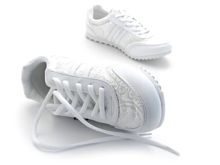 pair of running shoes over the white background