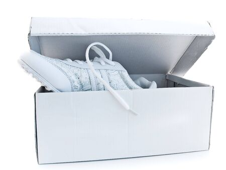 footgear: running shoes in the box over the white background