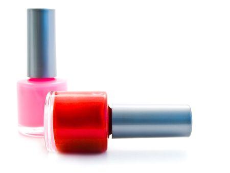 different color nail varnish bottles over white photo