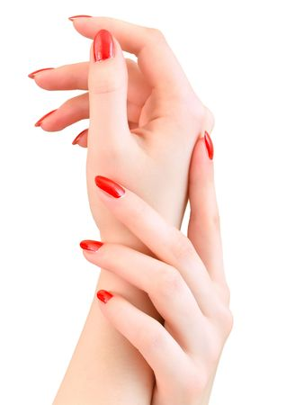 woman hands with red nails against the white background