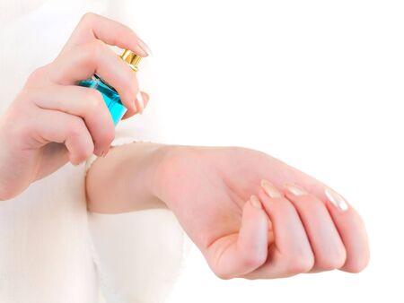 woman sprinkle perfume on her wrist Stock Photo - 4682452