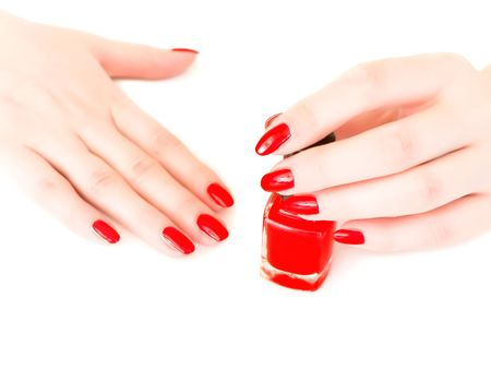 woman cover her nails with red varnish Stock Photo - 4760808