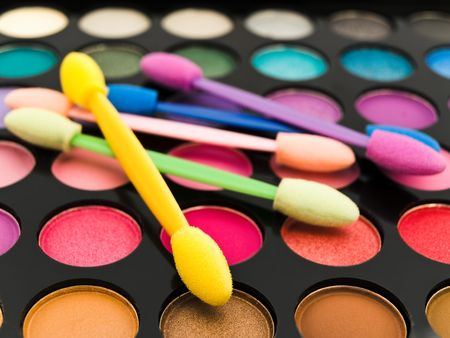multicolored eye shadows with cosmetics brush  photo