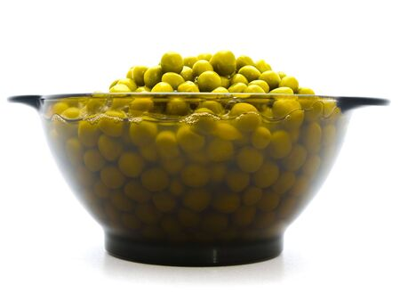 green preserved pea in the glass bowl against the white background photo