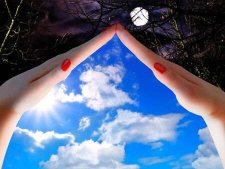 sky metaphor: day and night concept with woman hands blue sky and moon