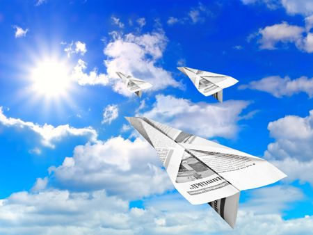 blue cloudy sky with sun and flying paper aeroplanes