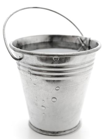water bucket: metal bucket with water against the white background