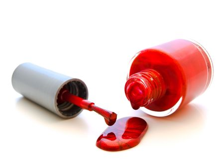 to lacquer: photo of the red liquid lacquer over white background